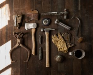 Bunch of tools on the table you will need to disassemble furniture when moving