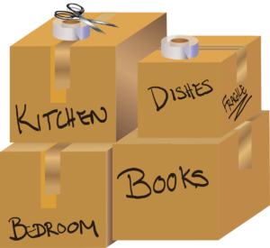 Stacked boxes with titles kitchen, dishes, bedroom and books on them, to help avoid injuries while moving