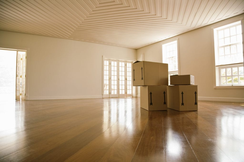 Moving boxes in empty room, representing union county movers