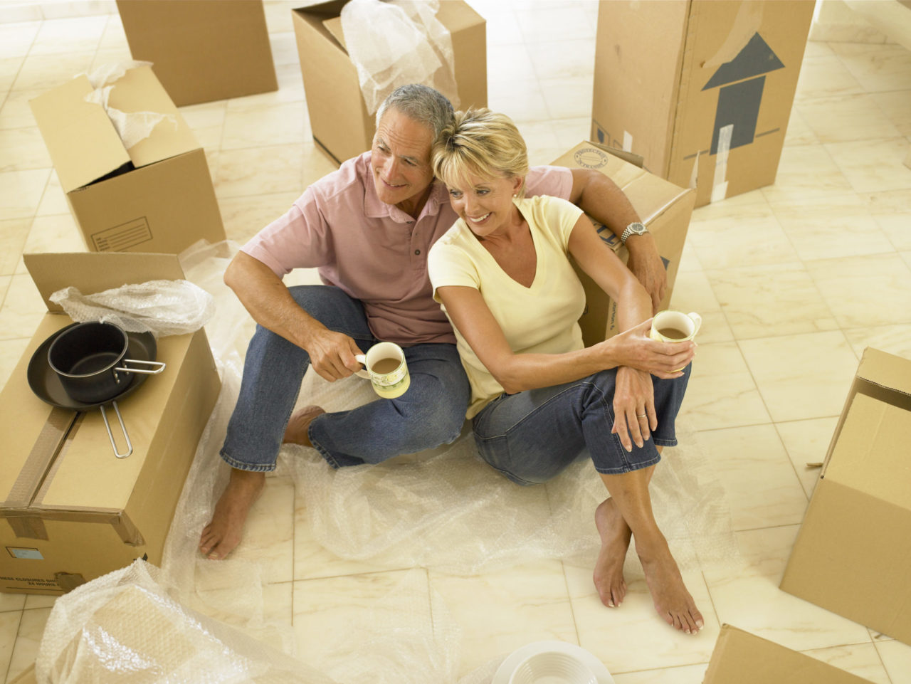 moving companies in Essex - Couple with moving boxesCounty NJ -