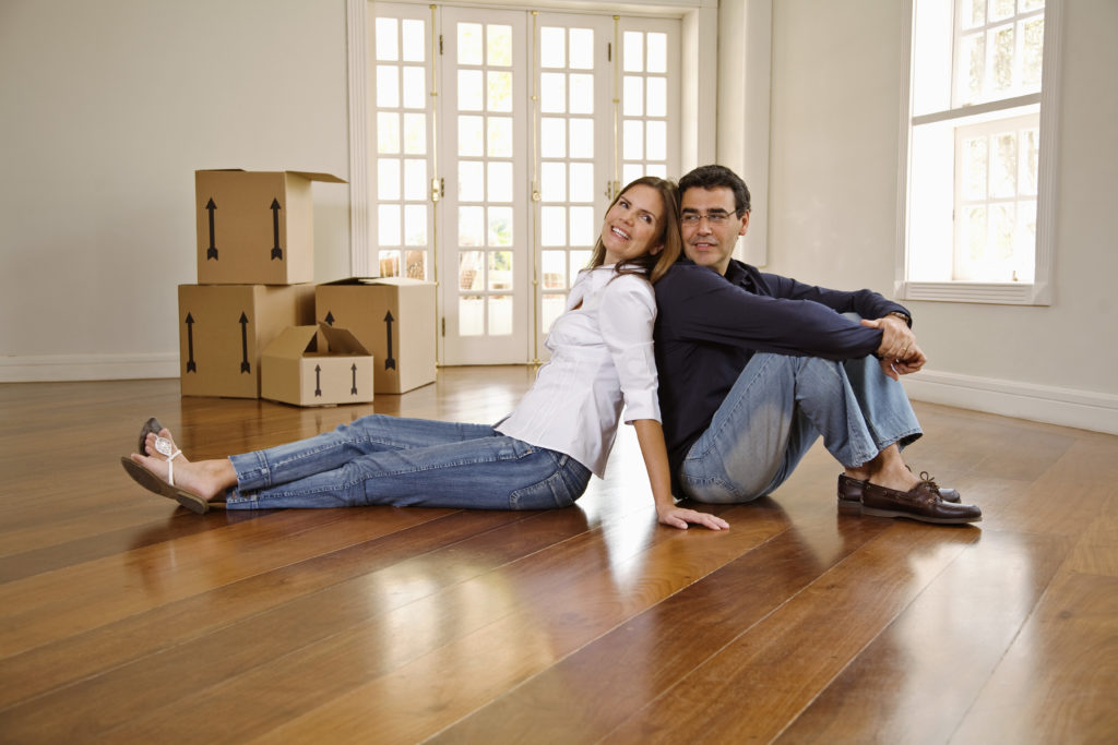 Couple sitting in new home after being moved by our movers Morris County NJ