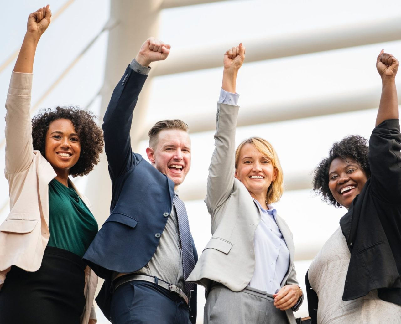 A group of people raising right hand