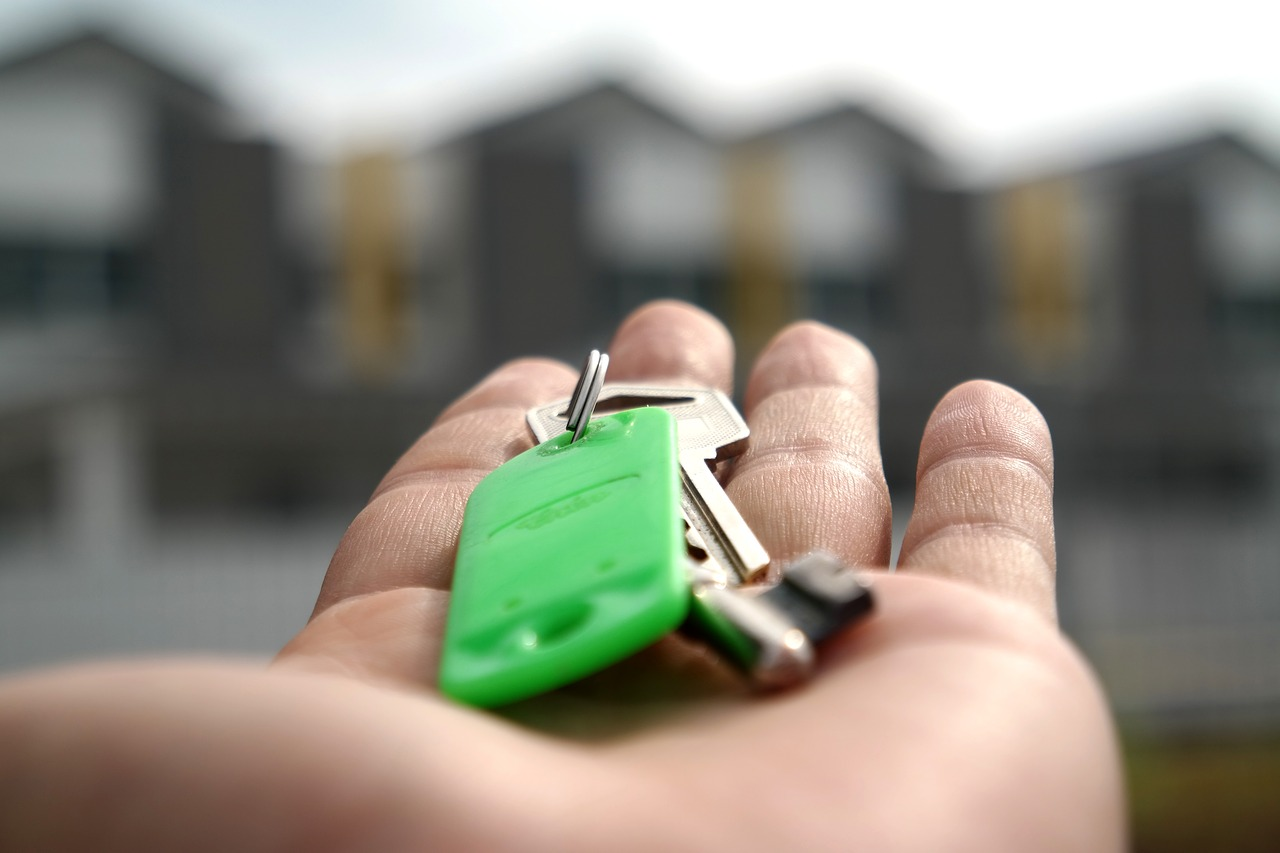 man holding key of a home where he has moved with the help of Millburn movers