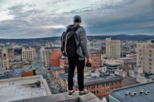 Man standing on rooftop in one of the best New Jersey cities for millennials