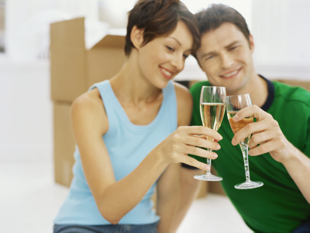 couple celebrating their move, representing moving essex county