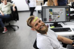 a smiling man in the office
