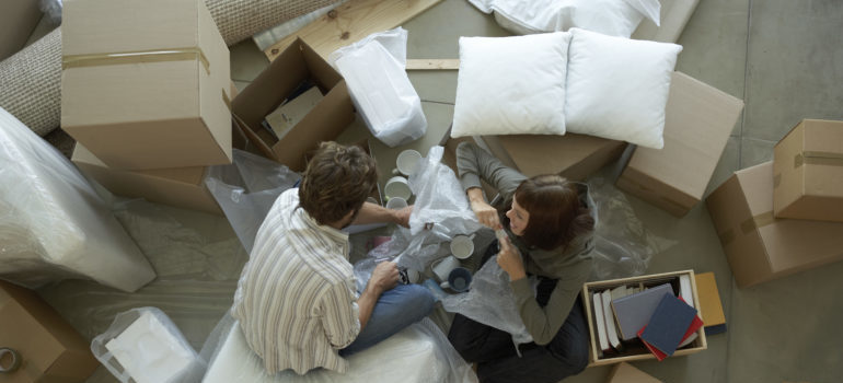 a couple moving into their new home, representing mendham nj movers