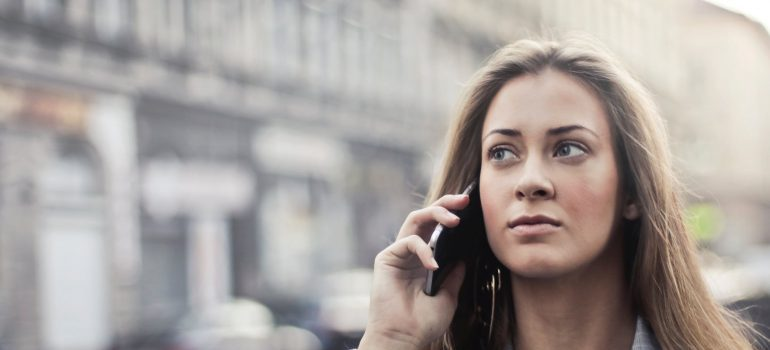 a girl talking on a cell phone