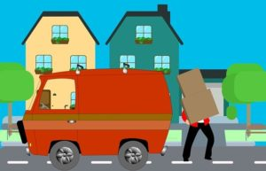 moving to Livingston - man loading boxes into a van