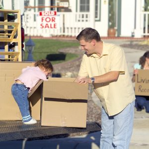 kinds of moving services - father and a daughter with moving boxes