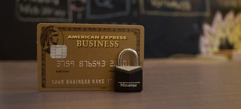 American express credit card and a black lock - How to interview Florham Park movers