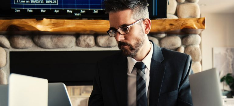 A businessman looking at his laptop