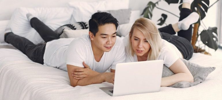 Couple reading a blog on laptop