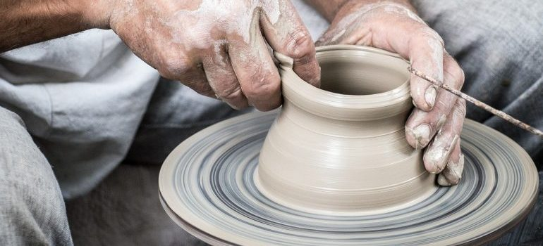 Man making clay cup as one of the things to do in Madison