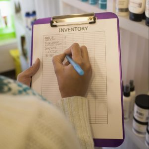 A woman making an inventory list