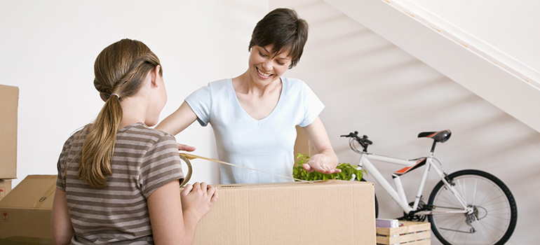 woman easily packing with the help of Bridgewater Township movers and out moving kits
