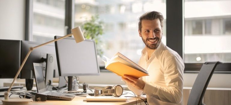 Man holding a book in the office