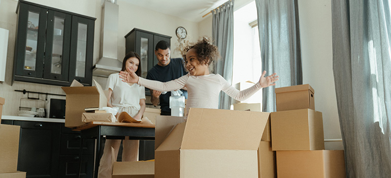 happy family getting ready for a relocation and waiting for Montgomery Township movers