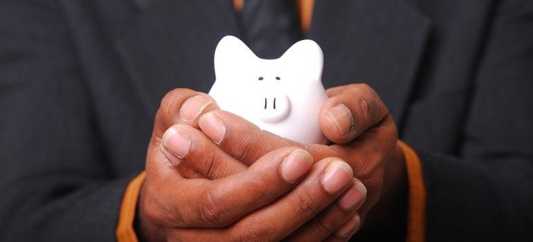 man holding white piggy-bank
