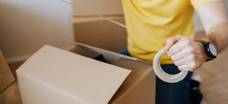 A man taping a box