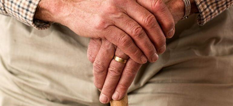 Senior holding cane
