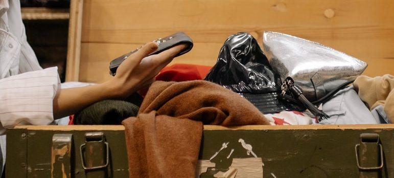 A woman shuffling through old items