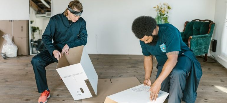 movers setting up boxes
