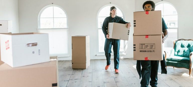 independence township movers carrying boxes