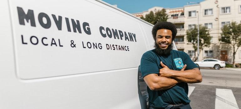 Mover standing in front of a van
