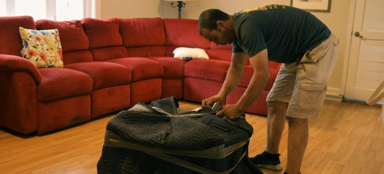 mover packing an end table