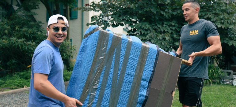 Moving services NJ carrying furniture
