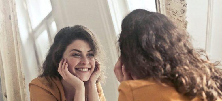 woman looking at a mirror