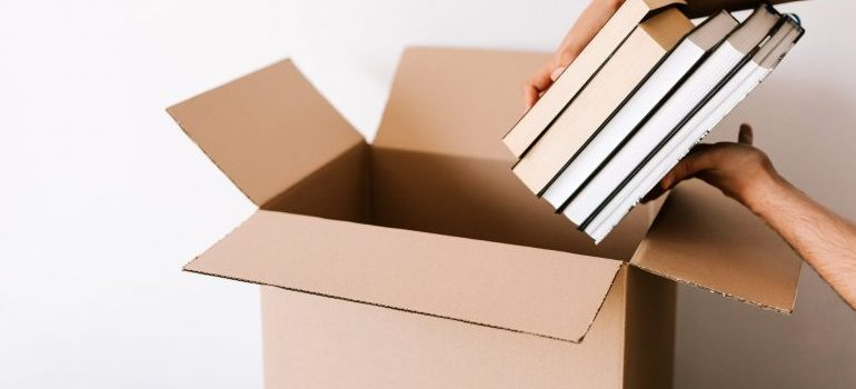 Putting books and documents to the right box.