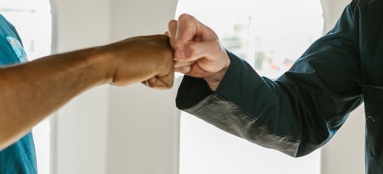 two hands making a fist bump
