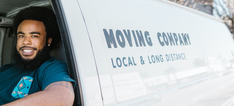 A man smiling in the van as a part of Roselle Park Movers