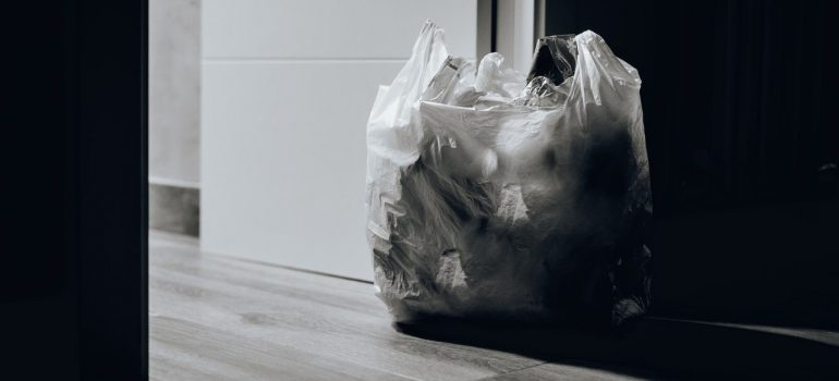 a bag of trash near the room enterance as a way to reduce waste when moving