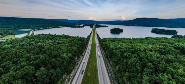 a beautiful road across a lake