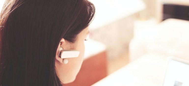 woman with an earphone in her ear