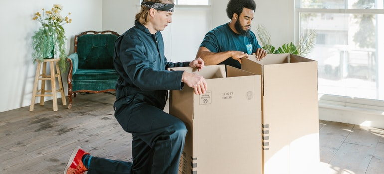 movers preparing boxes for moving bulky furniture