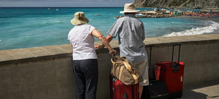 two seniors looking at a beach